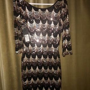 Dresses & Skirts - NWT ...Marciano sequin Black and gold mini dress